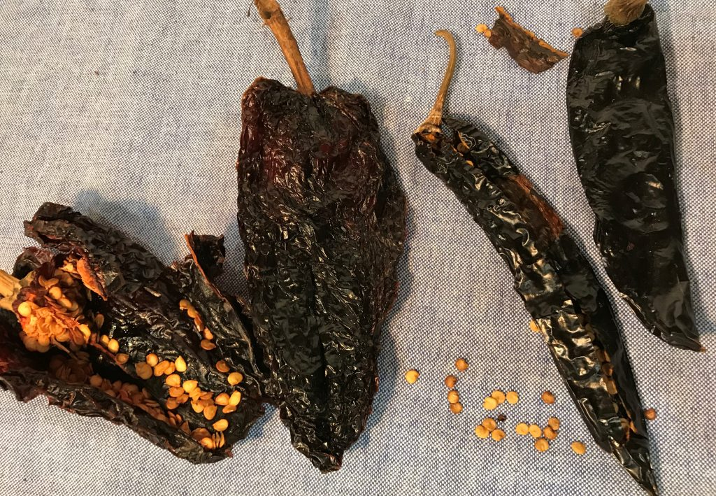 Dried chili's on blue cloth